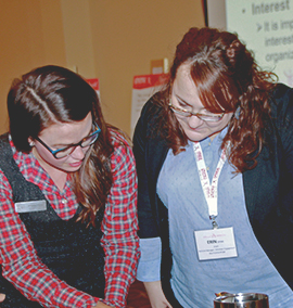 Crohn's and Colitis Canada staff member showing a volunteer some careers available in the organization