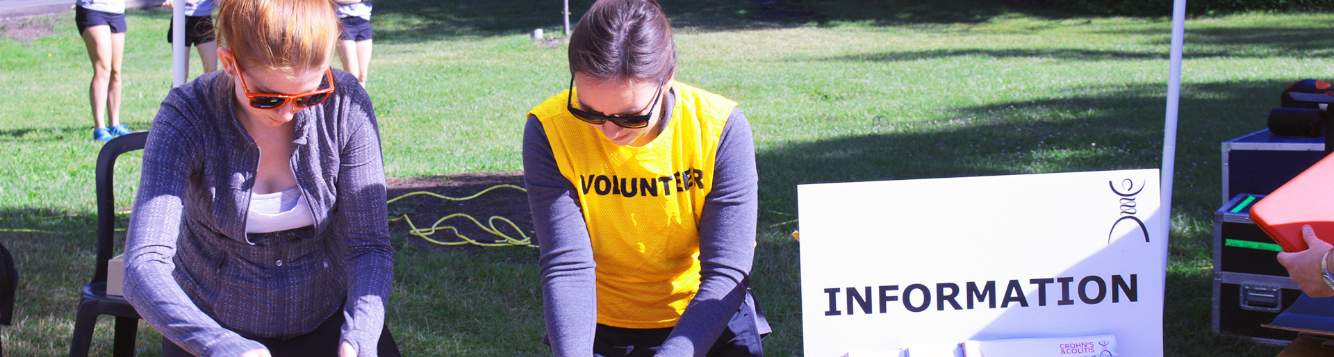 Volunteers working at a desk at Gutsy Walk