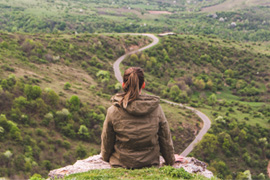 Young woman looking out in front of her journey