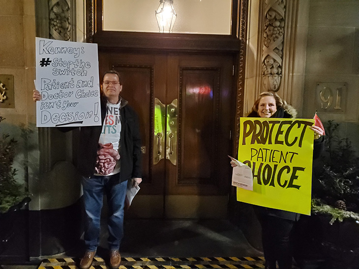 Protesters at the Albany Club