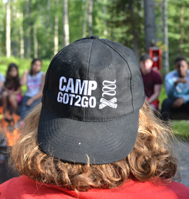 Camp Got2Go Youths gathered around campfire