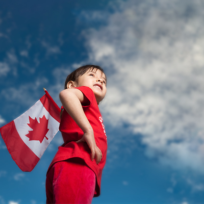 Boy with IBD holding a Canadian flag on Canada Day
